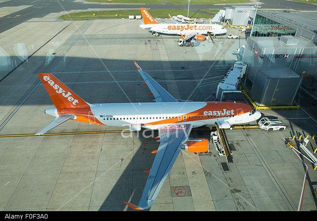 Gatwick Airport Apron With Easyjet Plane And Hsbc Jet Bridge Stock