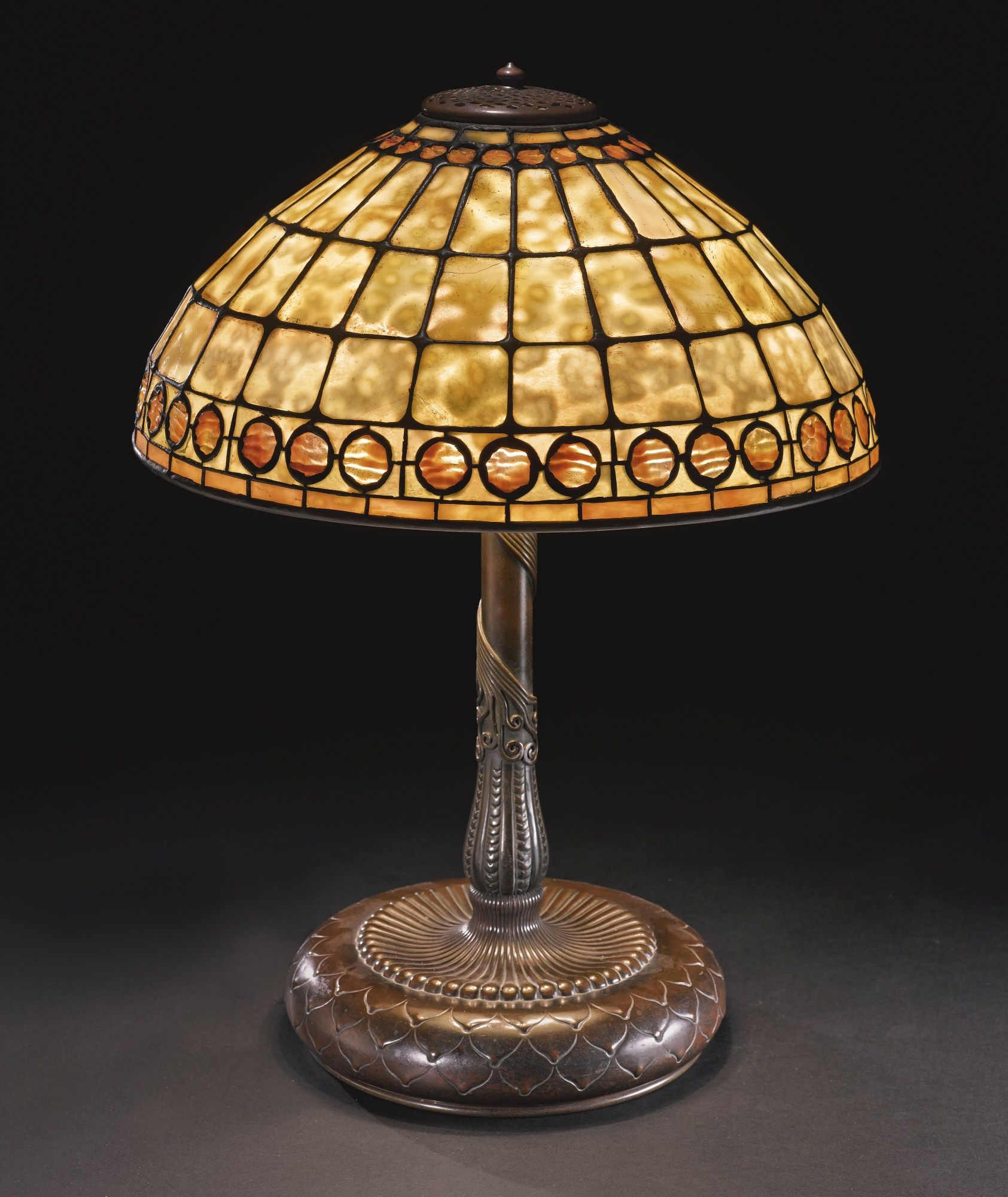 Tiffany studios new york geometric leaded glass and patinated bronze table lamp