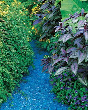 Be adventurous! A splash of color in unexpected places can make the difference between pretty and WOW in the garden /Like Colored glass . gravel. Just marvelous!
