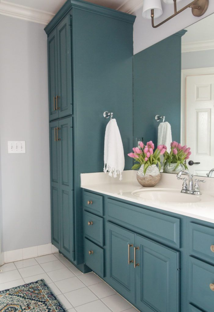 Photo of bold color in bathroom. painted cabinets