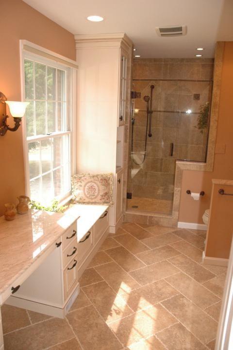 traditional bathroom with light tan tile shower wall