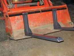 Pallet Forks - Homemade pallet fork attachment for a tractor bucket. Fabricated from C-channel and flat stock.