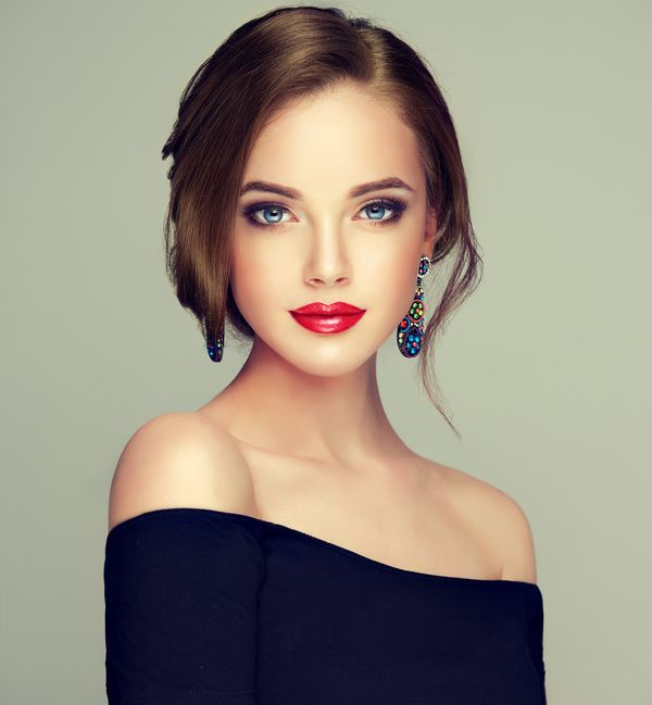 Beautiful Model Girl With Elegant Hairstyle . Woman With