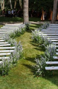 serpentine wedding aisle lined with wild lavender