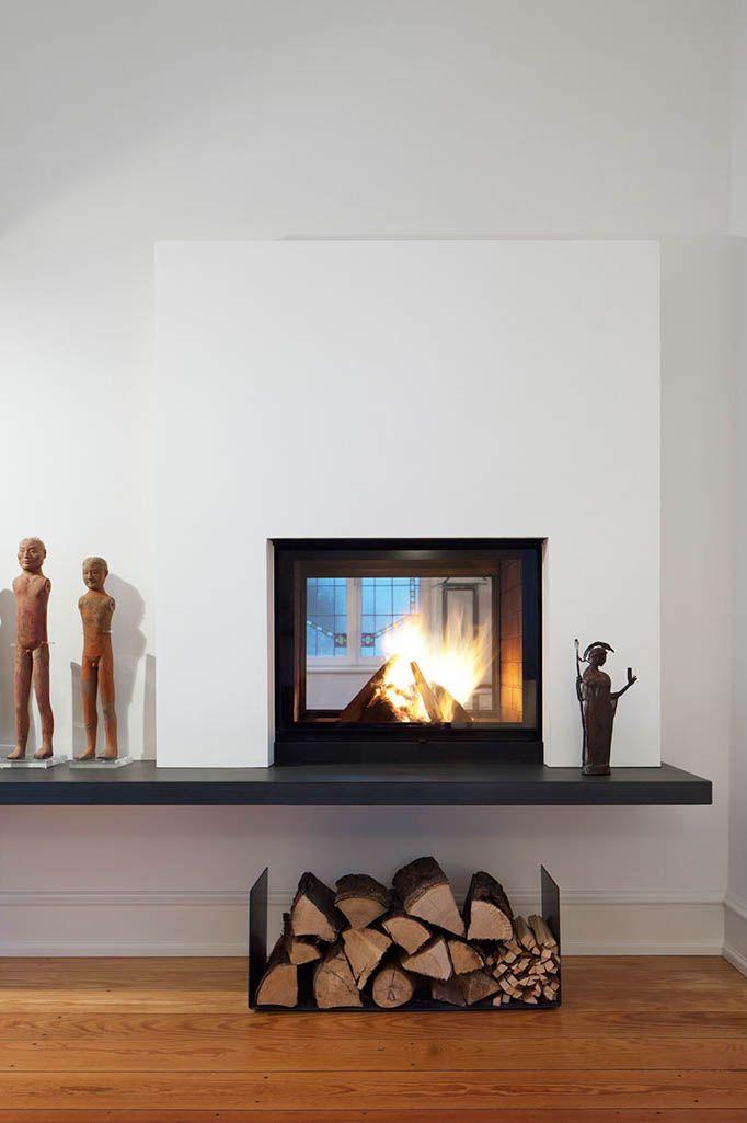Ein Tunnelkamin von Ruegg, in der Trennwand wziscehn Wohn- und - design kaminofen gemauert bilder
