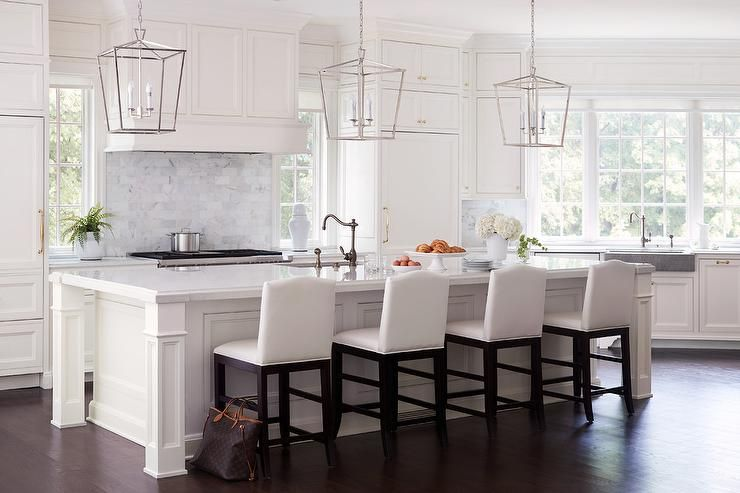 Three Darlana Lanterns Illuminate A White Kitchen Island With Four Enchanting Kitchen Lanterns Decorating Design