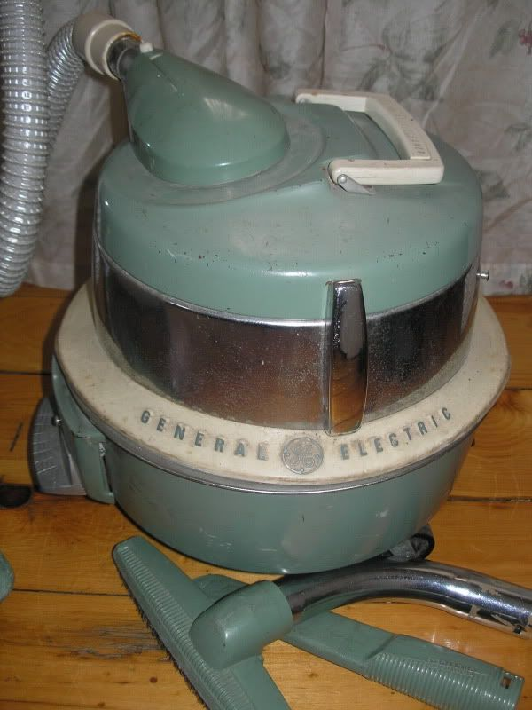 Antique Vacum Cleaners Pics Ge Cord Reel Cleaner Swivel Top Round Canister Vacuum Cleaner