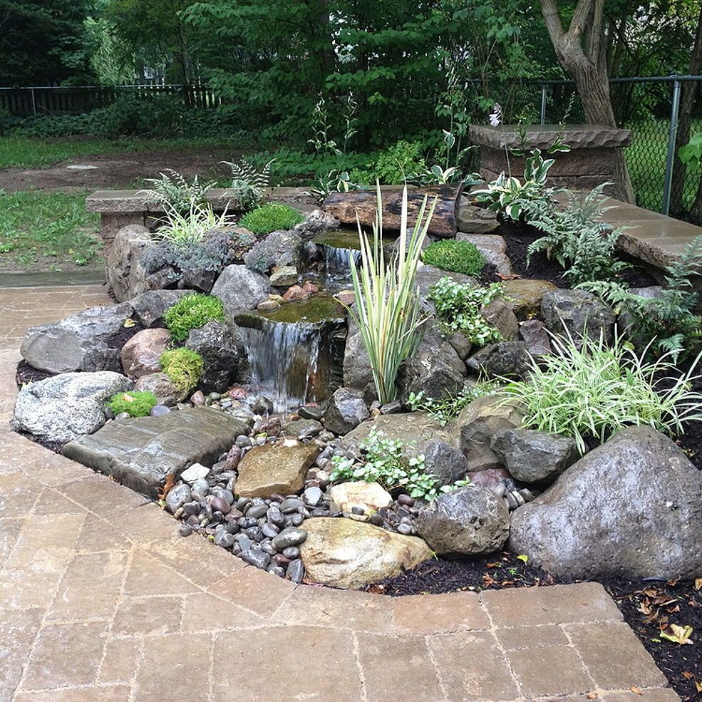 Landscape Garden Design, Waterfalls Water Feature, Patio, Sitting Wall with Pillars, Lighting, Landscaping, Brighton NY is part of Landscape garden Design - Acorn Landscaping Designs Backyard Landscape Design with Waterfalls, Patio, Sitting Wall with Pillars, Landscape Lighting and landscaping This is a great way to…