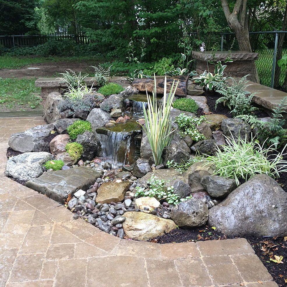 Landscape garden design waterfalls water feature patio for Images of garden water features