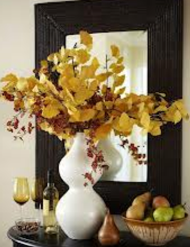 gingko branches in modern vase with orchids