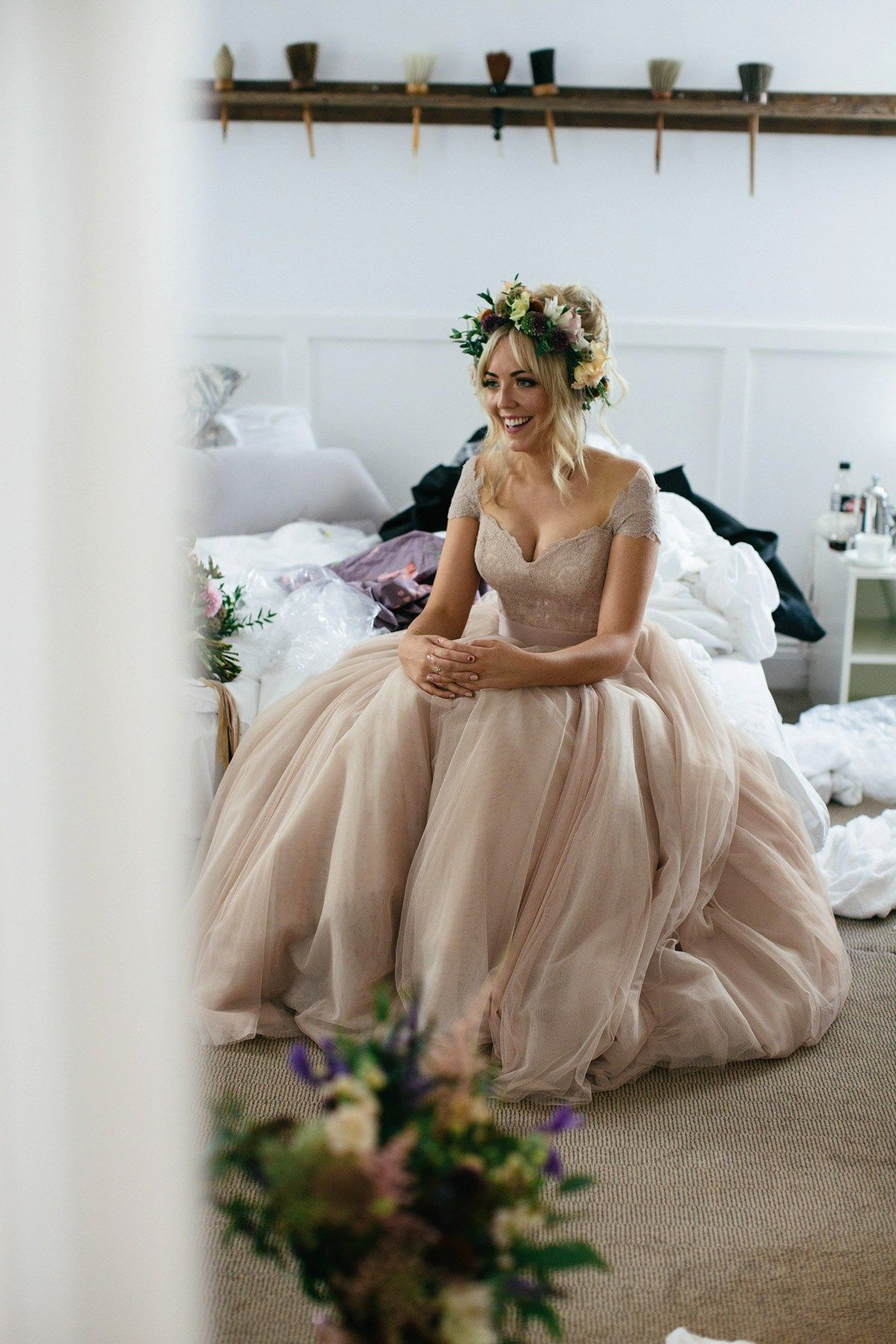 A dusky pink dress and floral crown for a romantic rainy day wedding