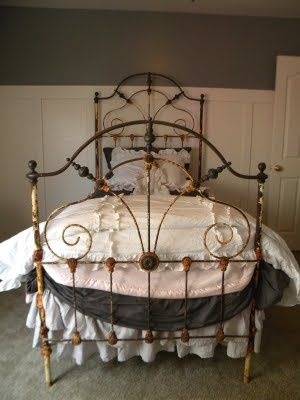 """It wasn't often that antique iron beds were made with so many great design elements as this one.......beautifully curved brass bar across the top, scrolled interior iron and a """"bowed footboard, give it a romantic feel.  #ironbeds #antiqueironbeds"""