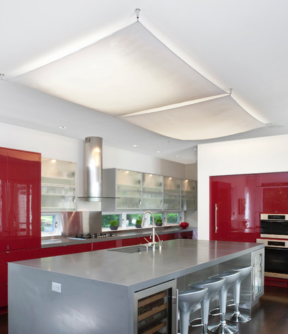 To cover up that kitchen light. Recessed fluorescent tube lights covered with a white fabric shade.                                                                                                                                                      More