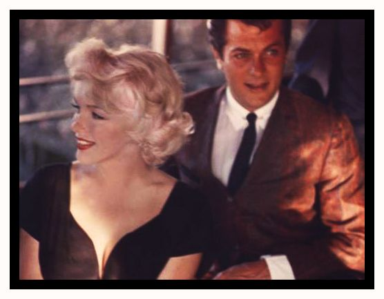 Marilyn Monroe with Tony Curtis. Curtis claimed that he had an affair with Marilyn which apparently began in 1950. They both went on to make the film Some Like It Hot, 1958.