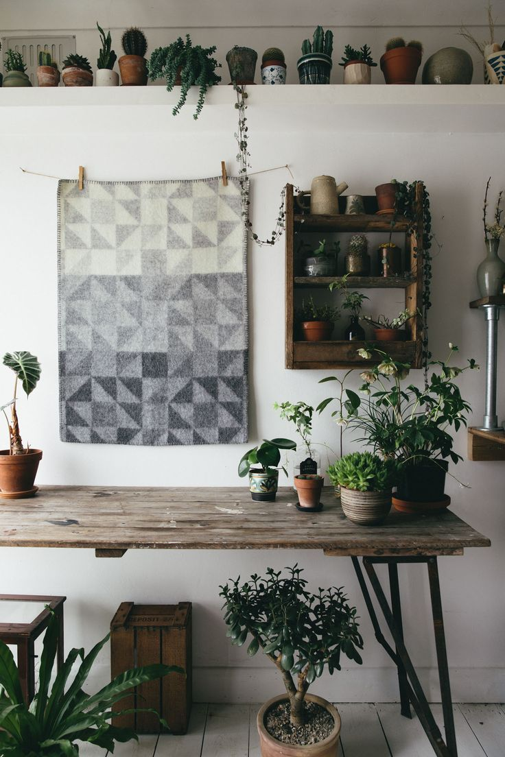 Pallet Wood Shelf, Plants, Rustic Table, Navajo inspired patterned blankets, all the details of the Modern Bohemian Home.