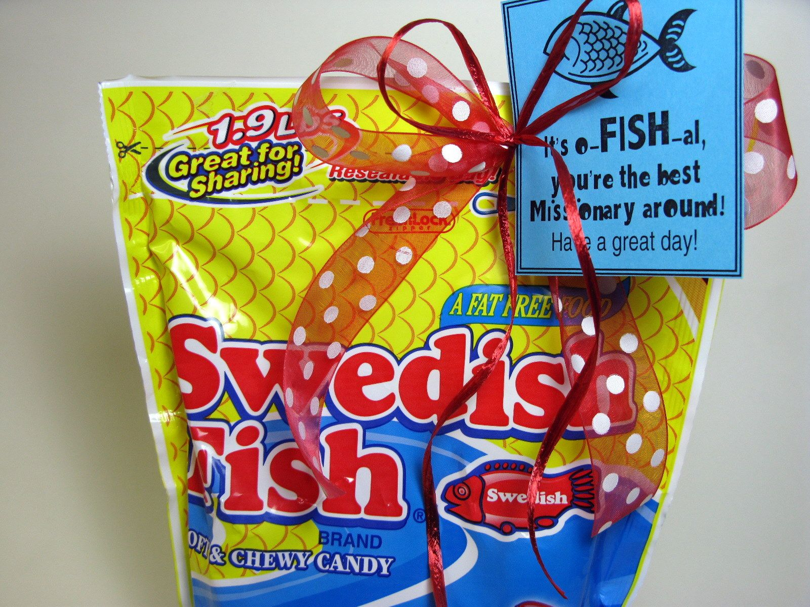 A bag of swedish fish with a tag that reads its ofish