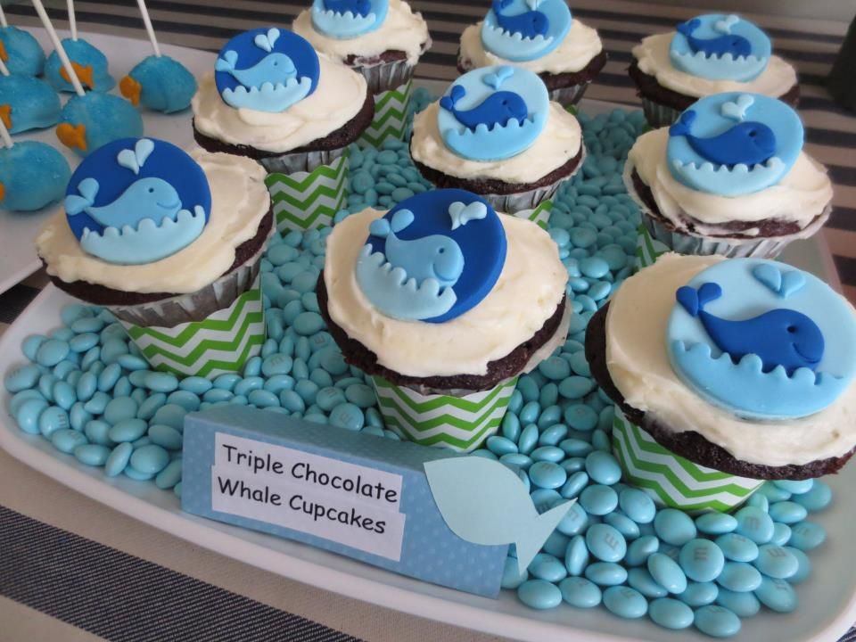 Customized whales cupcake toppers for a sweet table