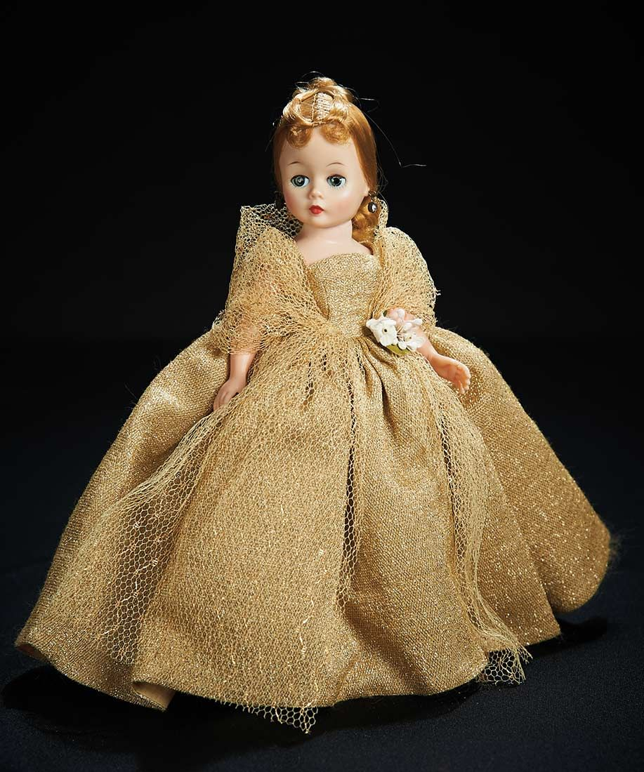 Stunning Blonde Cissette in Sparkling Gold Gown by Madame Alexander. http://Theriaults.com