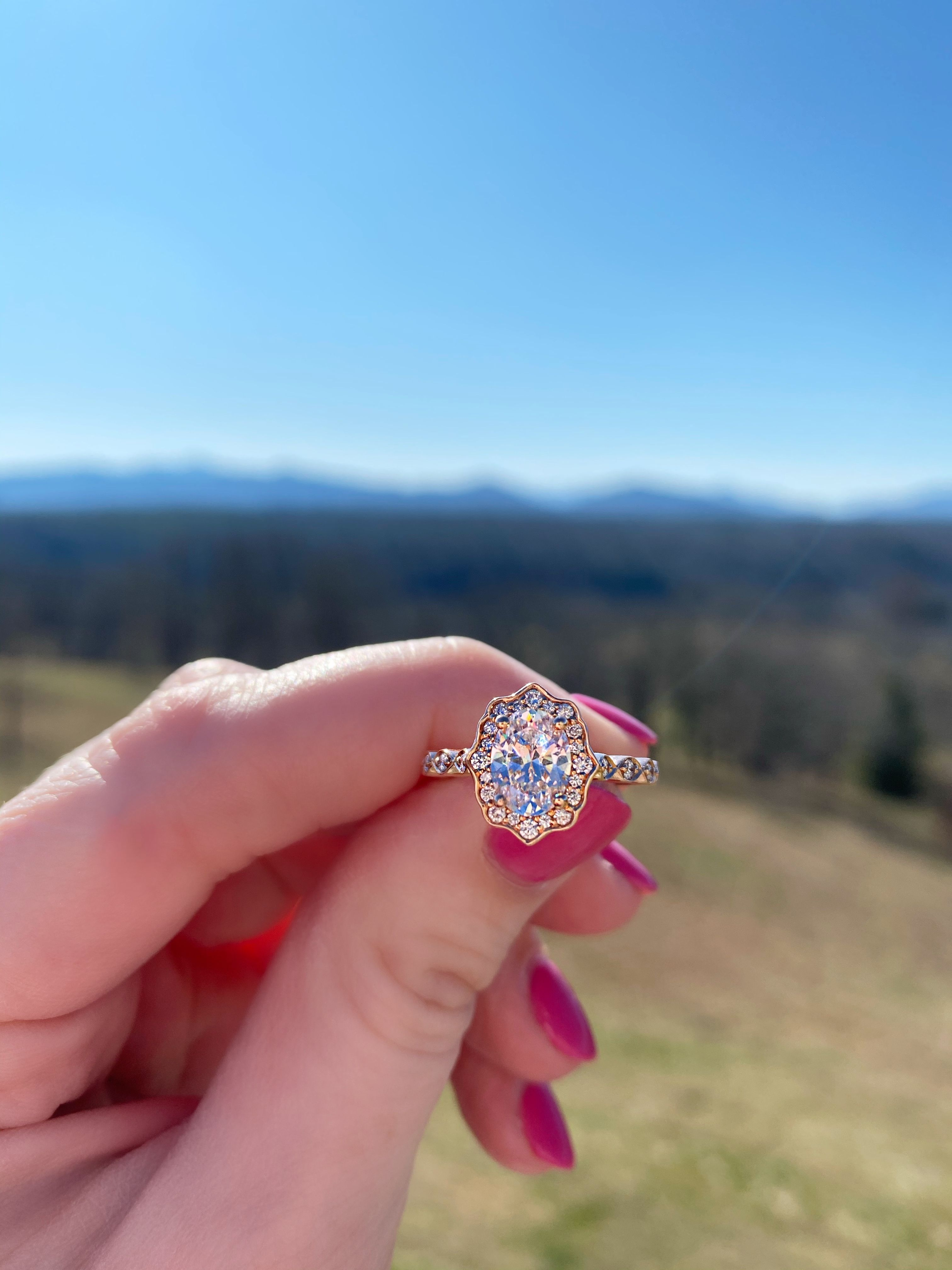 Vintage inspired oval diamond engagement ring setting in