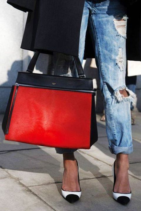 ripped jeans with a black & red CÉLINE tote.
