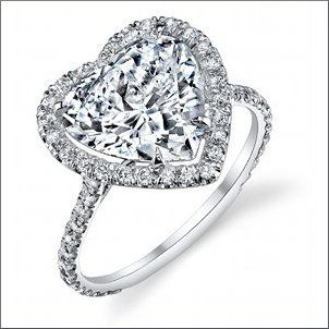 Stardust Design This beautiful heart shaped diamond set in a halo