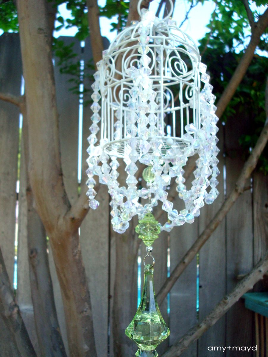 DIY chandelier...they have affordable mini birdcages in the dollar ...