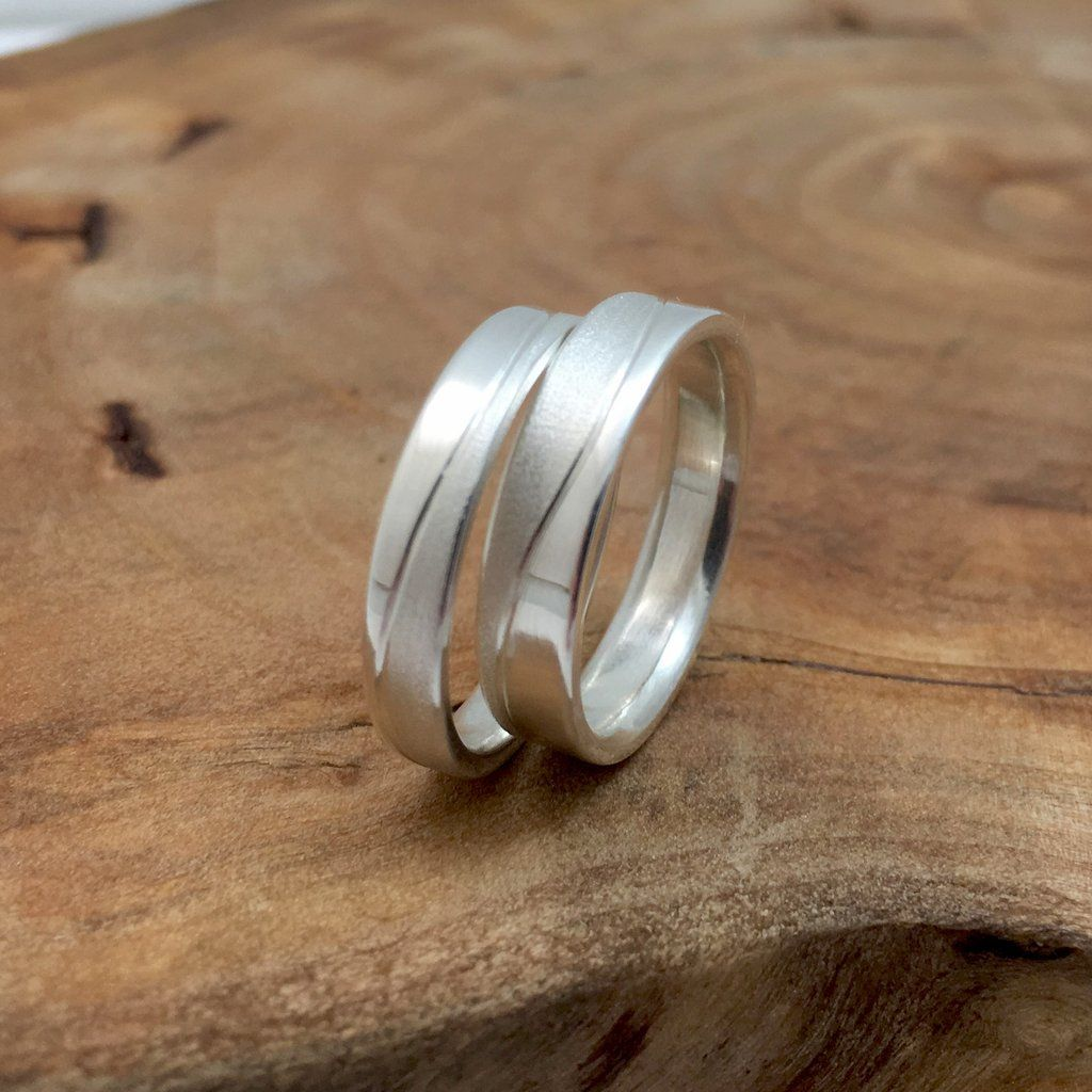 Couples Matching Silver Bands with Textured Wave Wedding bands