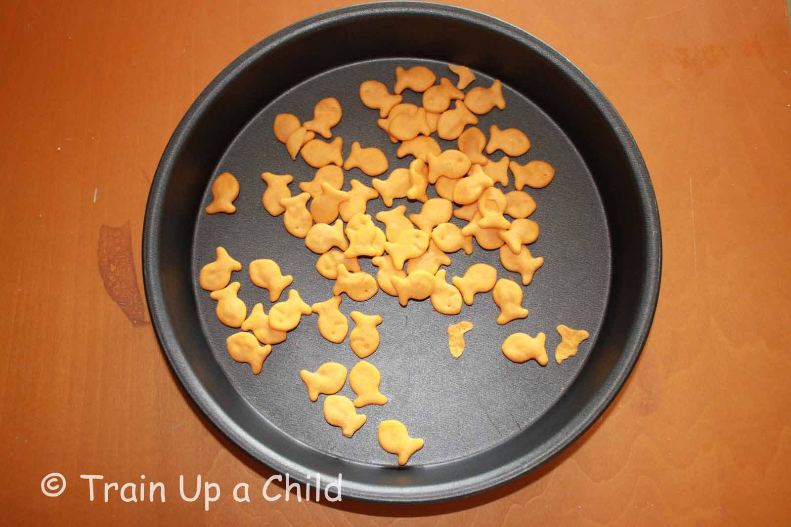 """Fishing for Lunch!  Celery rods with peanut butter """"bait"""" to capture the goldfish.  A healthy snack and fun activity in one."""