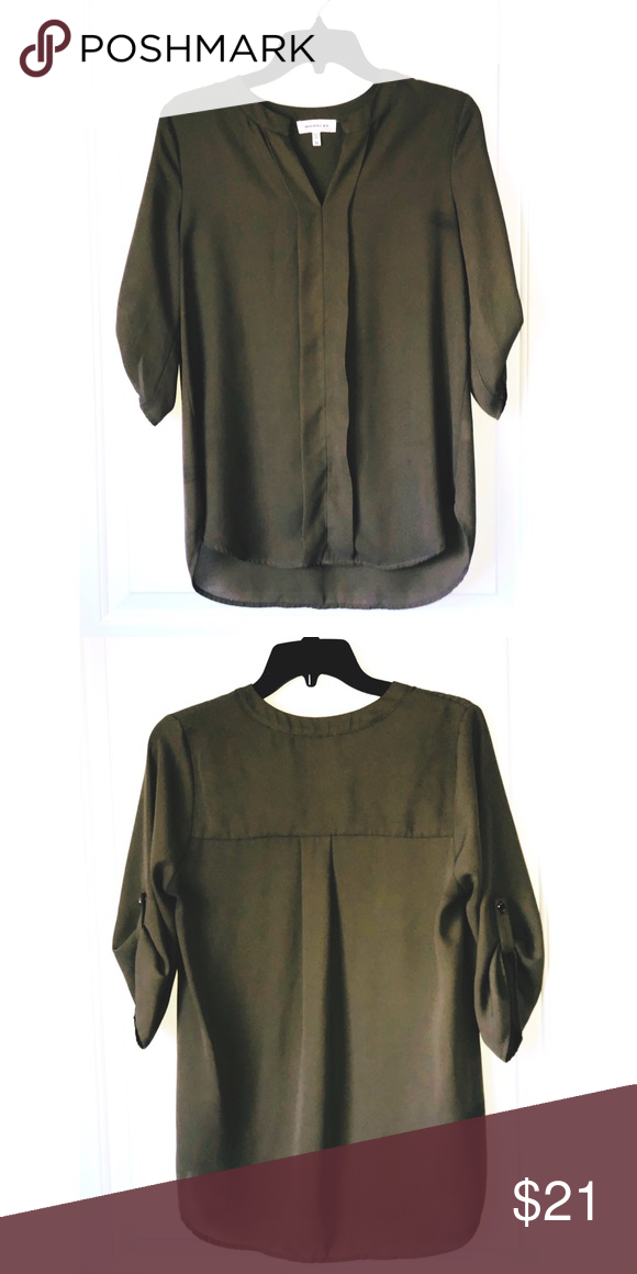 1f42c01afc0864 Olive green tunic by Monteau Hi low hem Pull on style Roll up sleeve and  button hold Monteau top size medium Monteau Tops