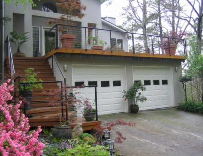 Balcony over garage deck over garage handrail if i had for Flat roof garage with deck plans