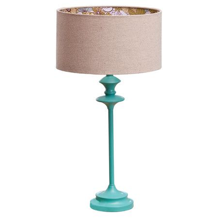 Add a sleek touch to your side table or reading nook with this eye-catching table lamp, showcasing a slim silhouette and blue finish.  Pr...