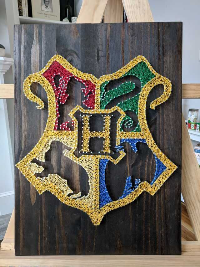 I made this Hogwarts crest string art!
