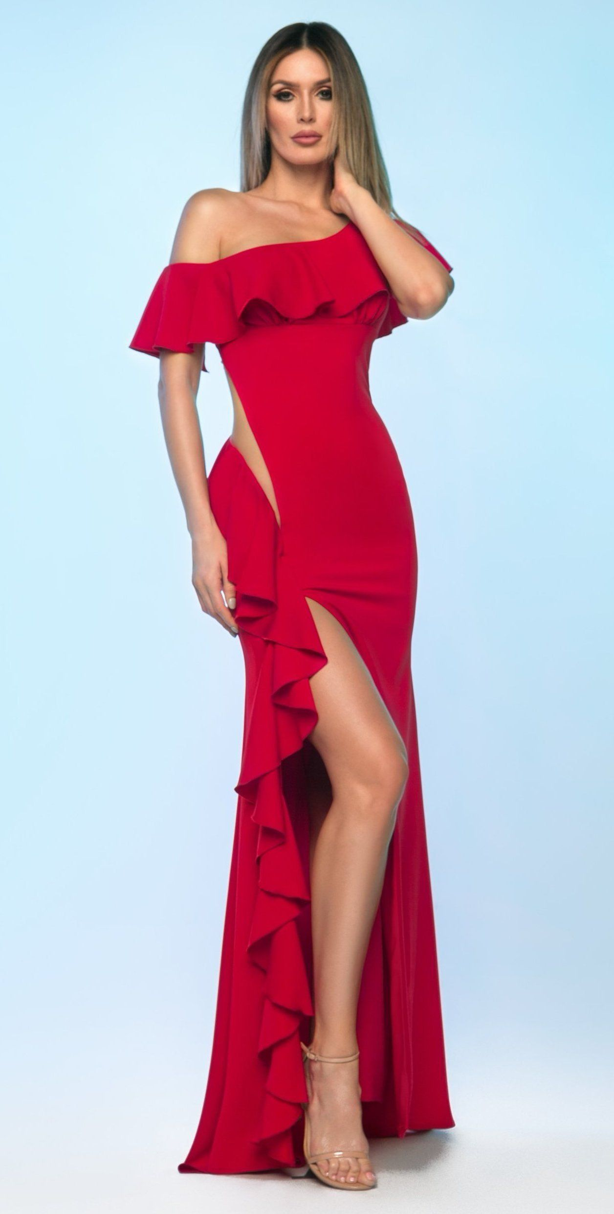 bb038f9615 6805 This sexy dress includes a high slit and peekaboo element with ruffle  accent for a romantic night out. Ships Within 7-14 Business Days