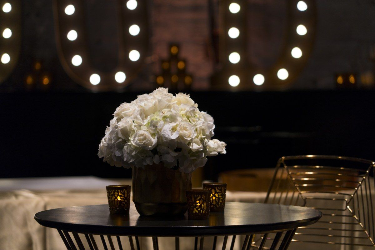 Gold Vase With White Flowers At Black And Gold Event Great Gatsby