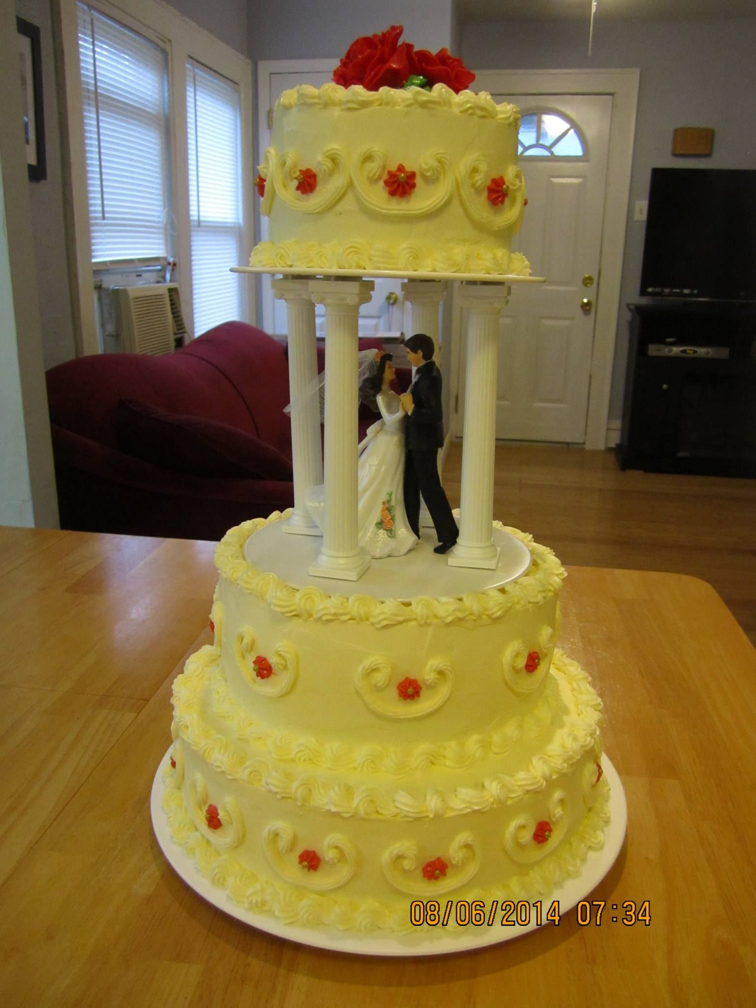 3 tiers wedding cake with first dance topper on the middle of the ...