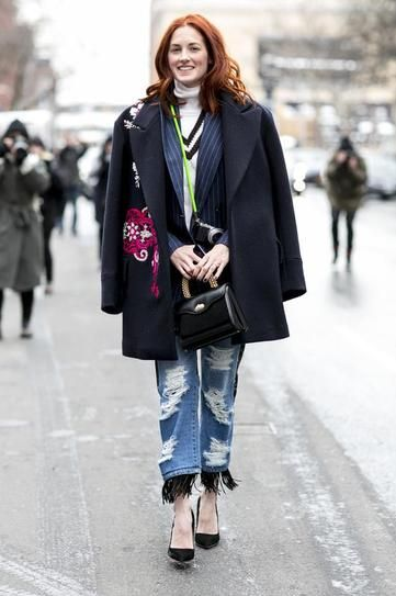 100 best dressed of 2014 - Taylor Tomasi Hill wearing a black winter coat over a pinstripe blazer + ripped boyfriend jeans with fringe hem