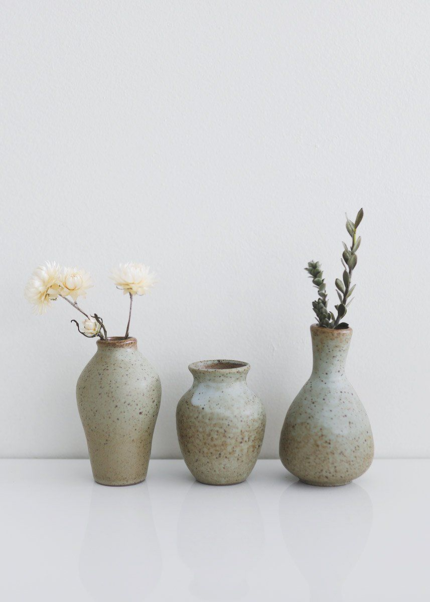 Find stylish table vases for the home, like this set of pale green blue and brown glazed ceramic flower bud vases. Each vase will vary in color due to the unique process of the reactive glaze finish.  Pale Green Blue and Brown Set of 3 4