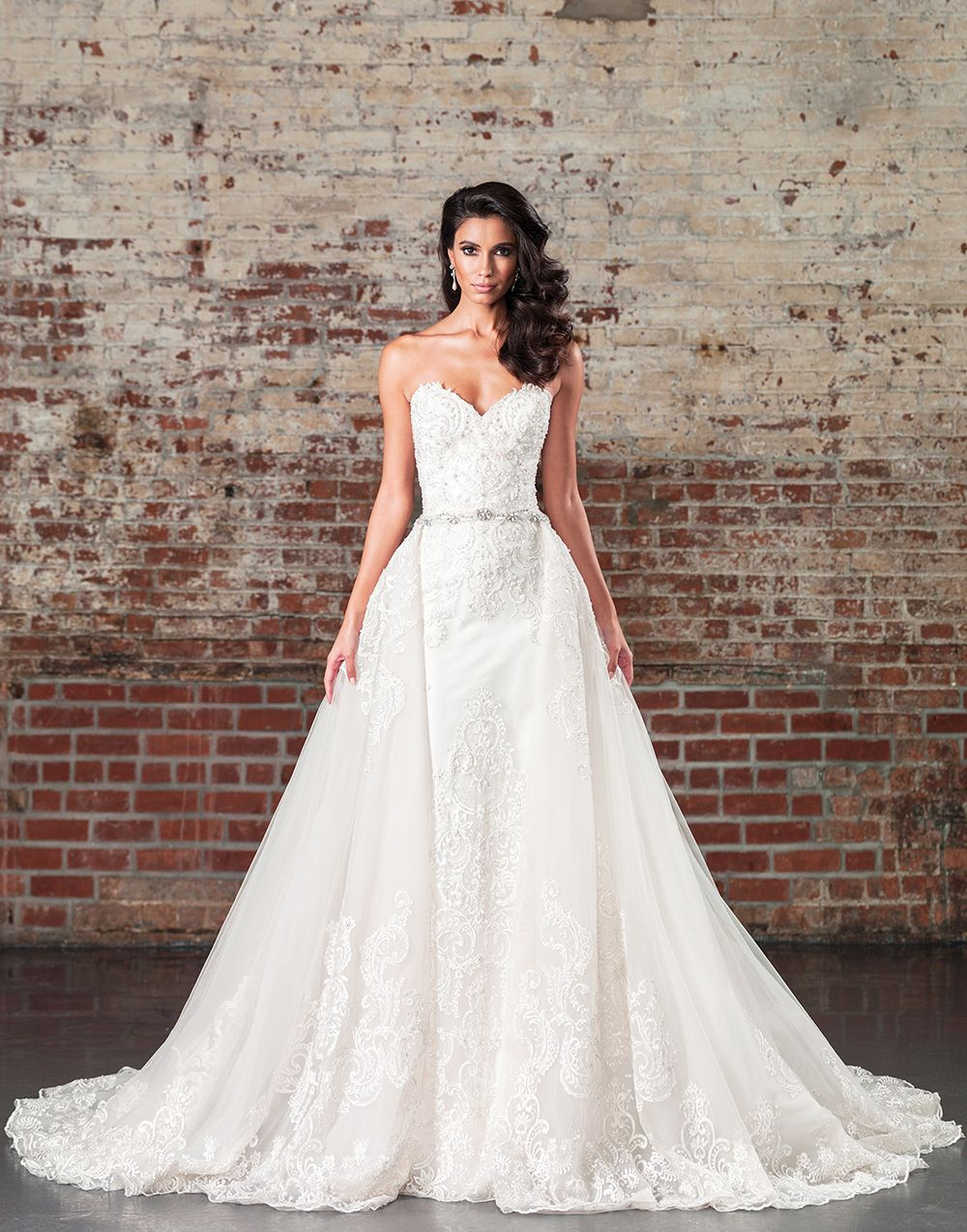 a2959cfaf74a Walk down the aisle in this strapless sweetheart gown with a detachable  cathedral length skirt with buttons to the end of the train.