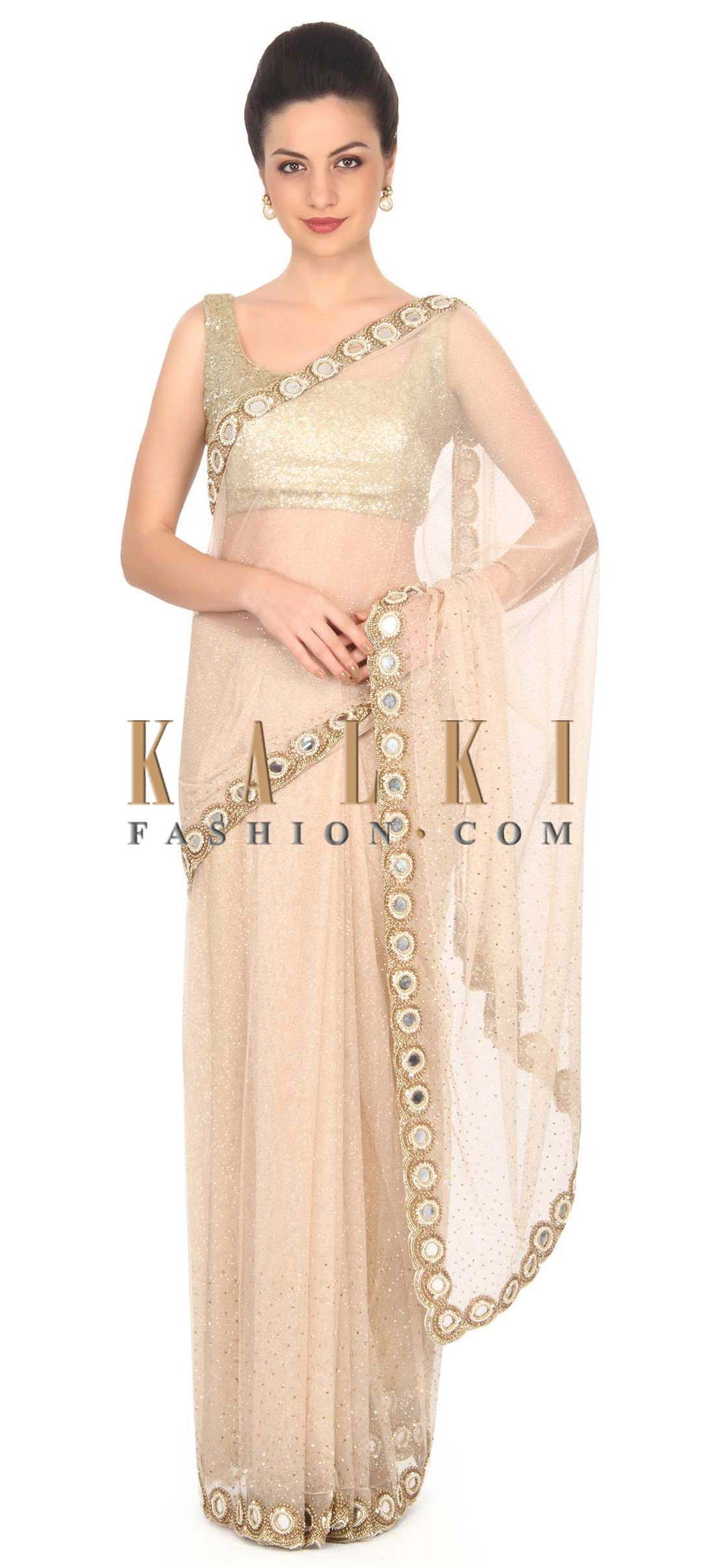 433974d75d Buy this Beige saree adorn in kundan and mirror border only on Kalki ...