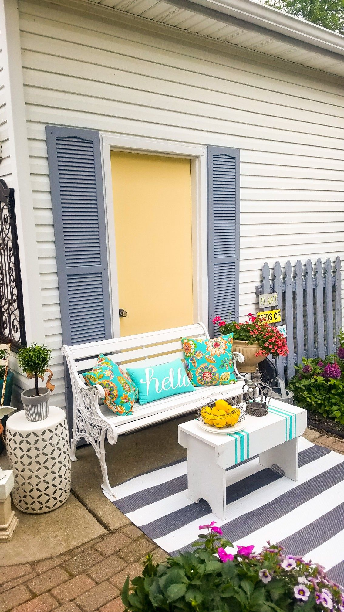 Gray Yellow And Turquoise Patio Area Rhe Side Of
