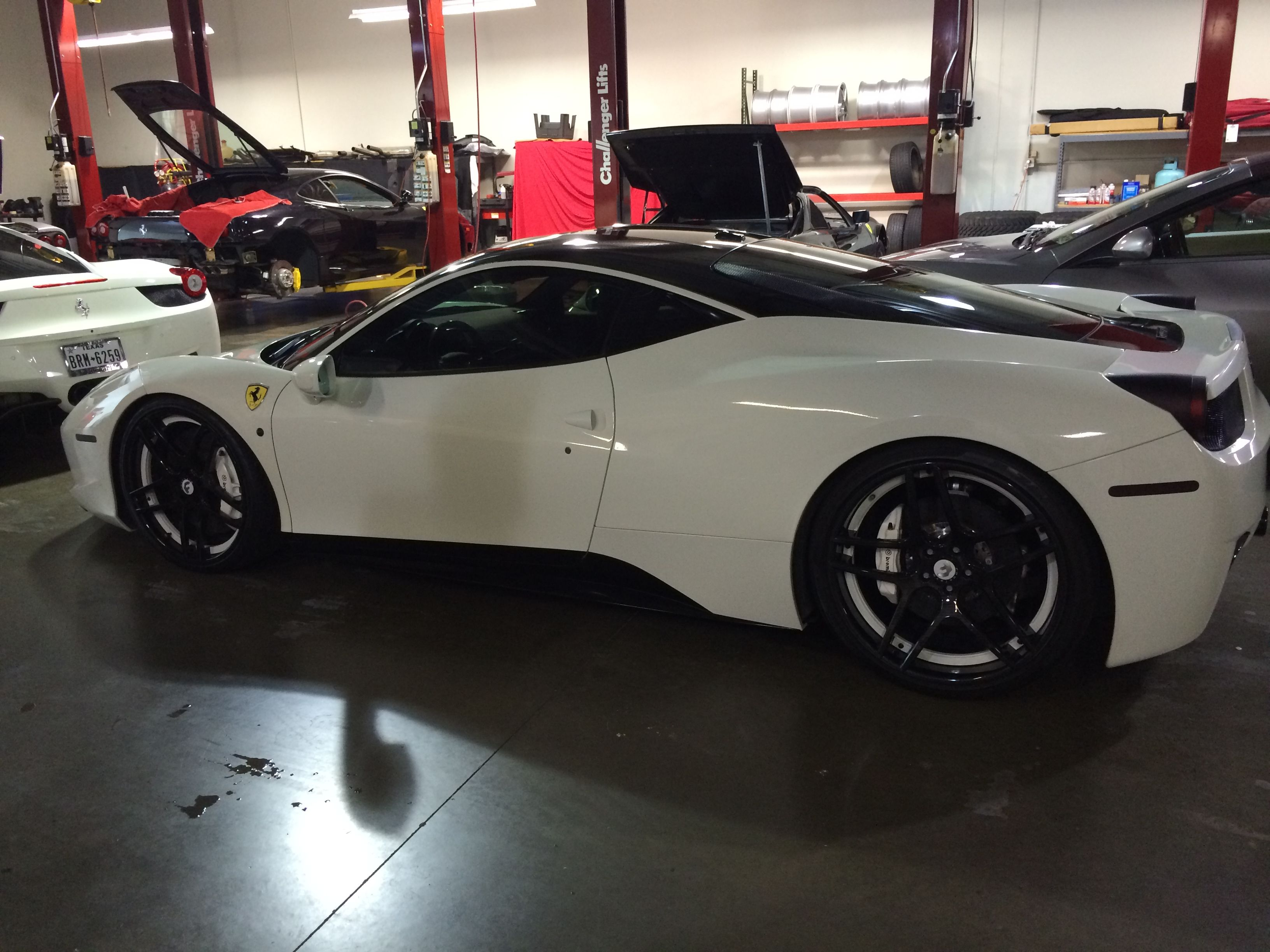 Getting ready to work on a special project for Ferrari. This custom Italia was in one of the garages of the dealership. We'll be filming a 458 Spider.