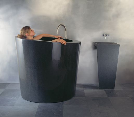 Oval Soaking Tub With Zero Pedestal Sink Black Granite By Stone Forest Each Design Is Carved Small Bathtub Japanese Soaking Tubs Small Bathroom Inspiration Japanese soaking tub for sale