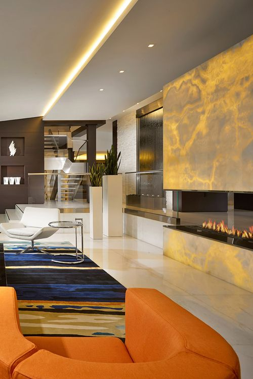 Living area with water fall and fireplace Interior Design - wohnzimmer orange braun