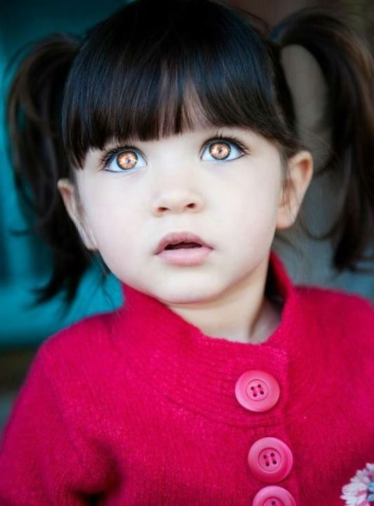 little girl with black hair and big brown eyes awww