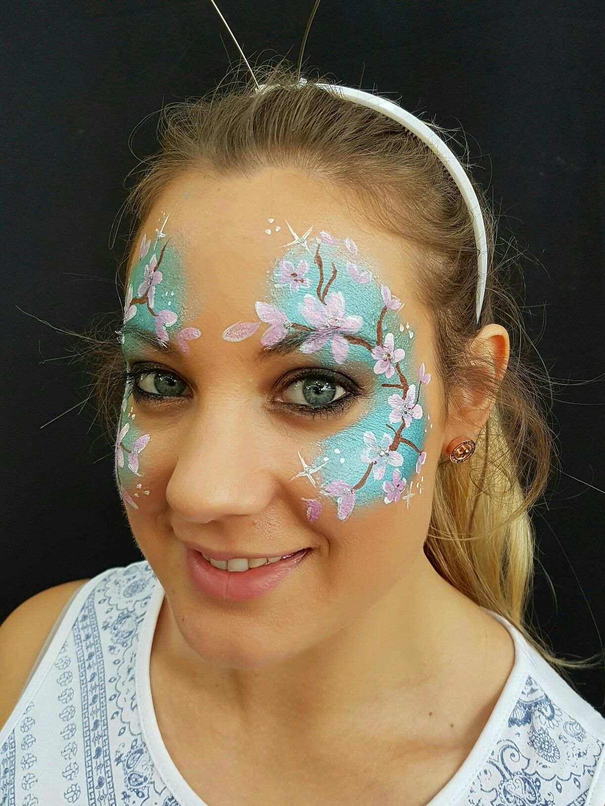 Cherry blossom face painting Face painting, Face, Face paint