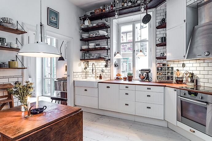 Beautiful #kitchen in #apartment with white #interior combined with old style, classic wood textures.