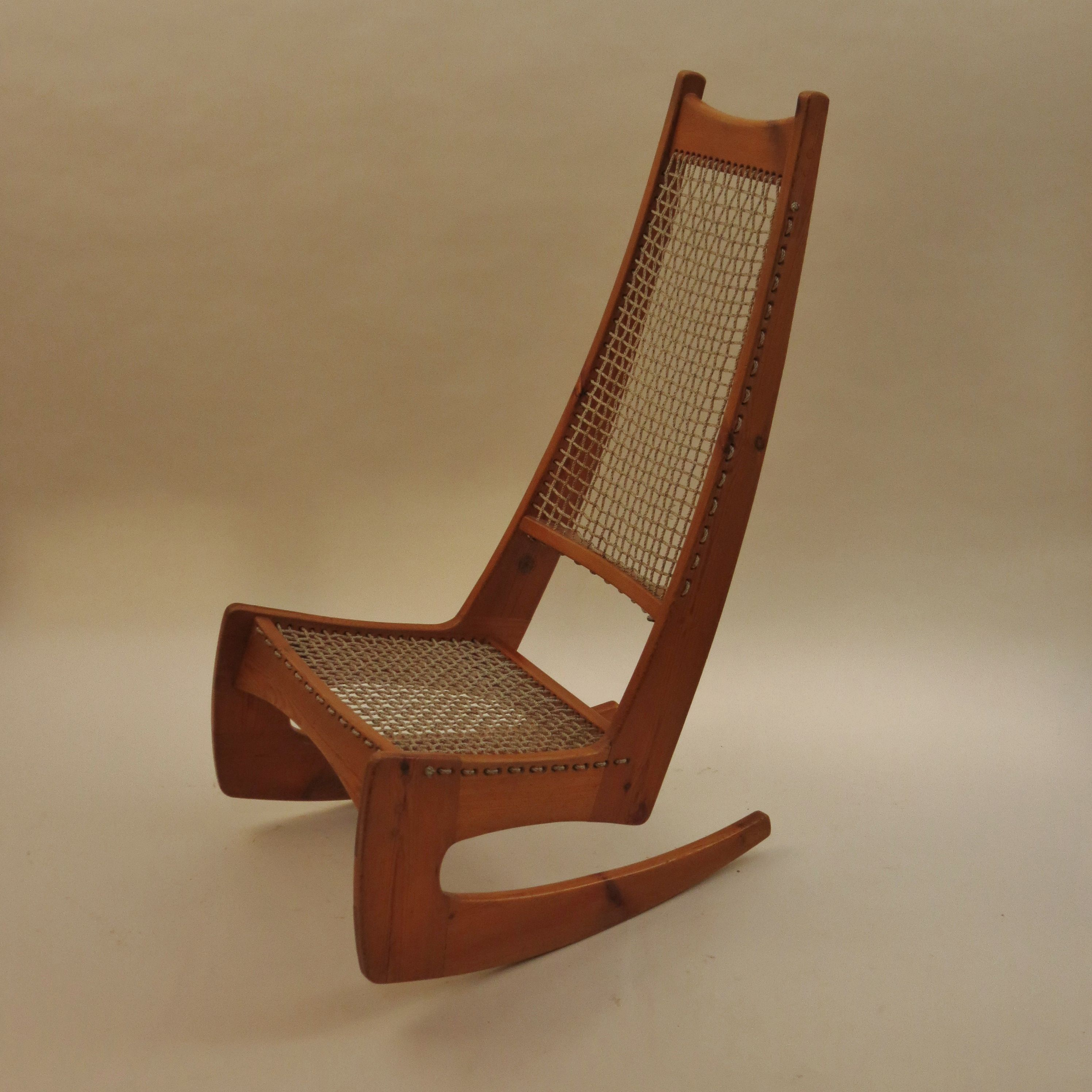 http://www.decorativemodern.co.uk/decorativemodern/jeremy-broun-high-back-rocking-chair/