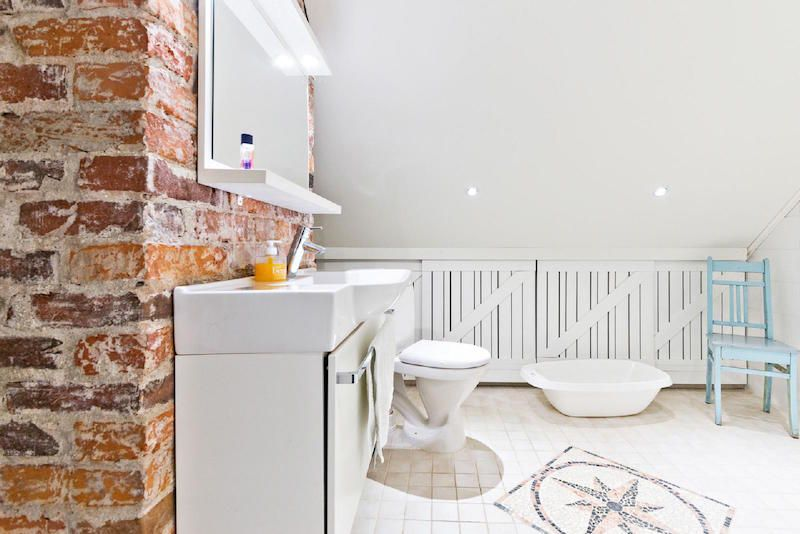 Rustic brick wall in bathroom