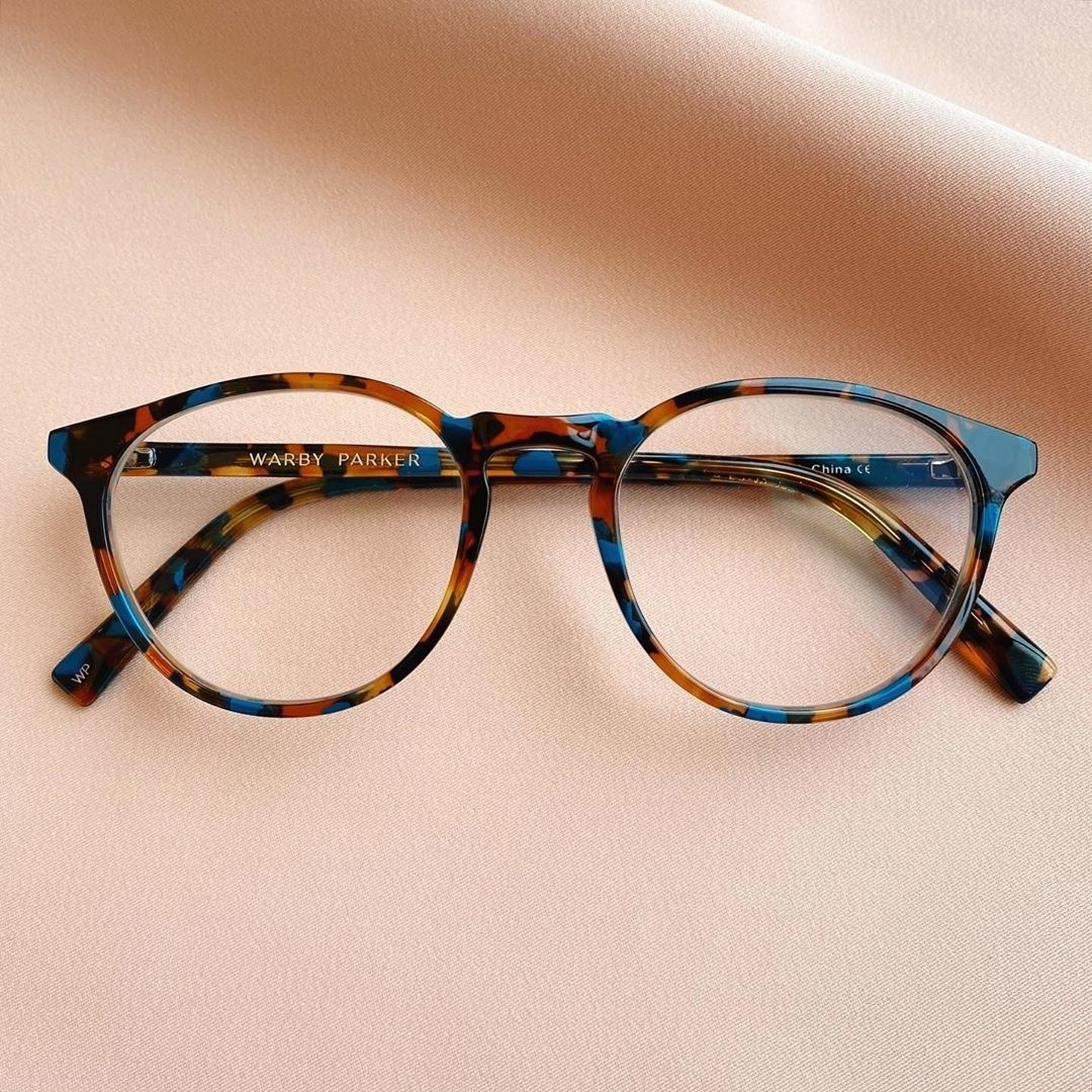 Photo of These sleek and studious frames that are a funkified interpretation of old-school bookworm glasses. The combination of caramel hues and unexpected blue gives the traditional tortoiseshell pattern a modern-day update.