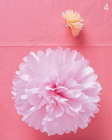 tissue paper pom-poms and flowers. Super easy and cheap and takes up loads of ceiling space!